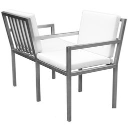 Bequeme Bank aus Edelstahl für den Garten. Gepolsterte Sitzflächen sorgen für ein entspanntes Sitzen. Edelstahlbank im Bauhausstil von Lizzy Heinen.